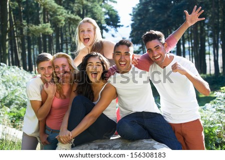 Group Of Young People Relaxing In Countryside - stock photo