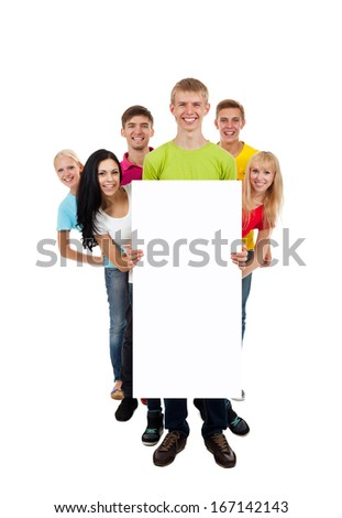 group of young people smile holding a blank white card board, signboard, show empty bill board, full length portrait isolated over white background - stock photo
