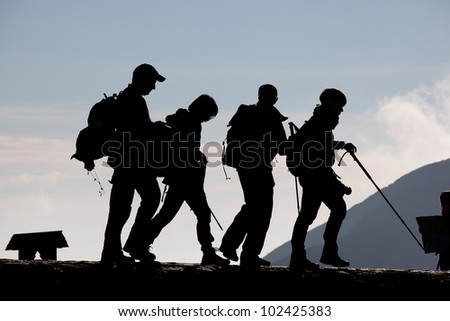 Group of young people trekking in the mountains - stock photo