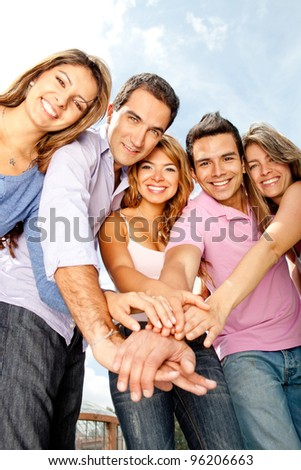 Group of young people with hands together - teamwork concepts - stock photo