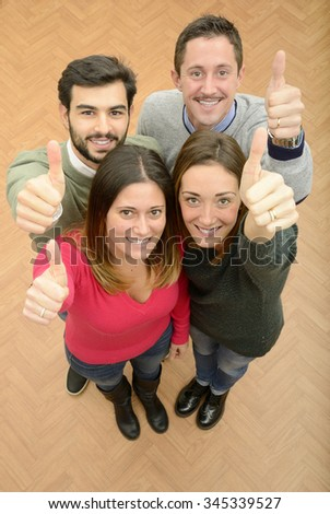 Group of young people with thumbs p - stock photo