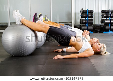 group of young people workout in gym with fitness balls - stock photo