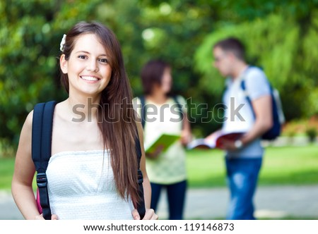 Group of young students in the park - stock photo
