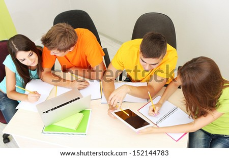 Group of young students sitting in the room - stock photo