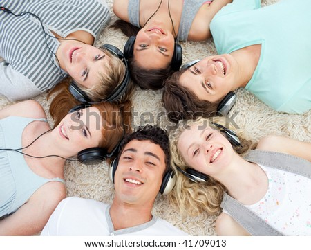 Group of  young Teenagers listening to music - stock photo