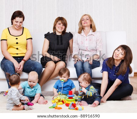 Group of young women and sweet kids playing - stock photo