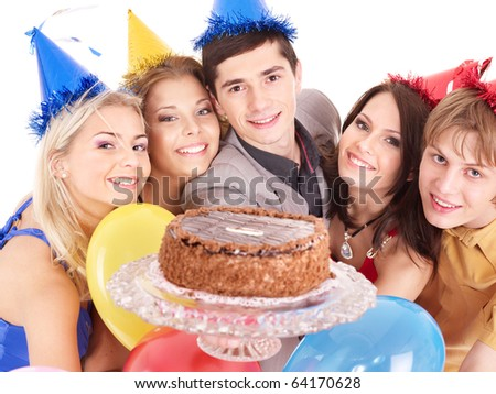 Group people in party hat holding cake. Isolated. - stock photo