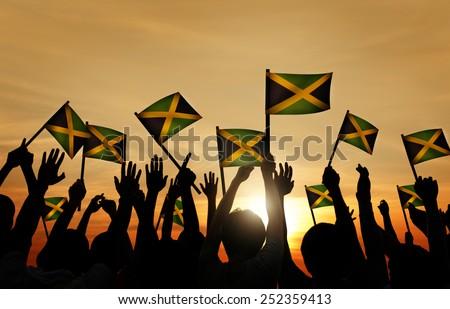 Group People Waving Flag Jamaica Back Lit Concept - stock photo