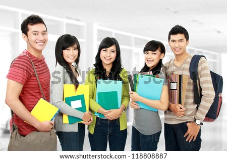 Group portrait of asian students in campus - stock photo