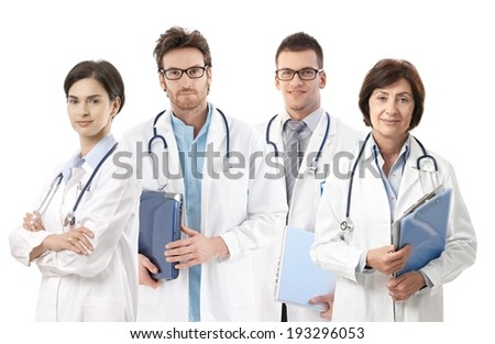 Group portrait of doctors on white background, looking at camera, smiling, - stock photo