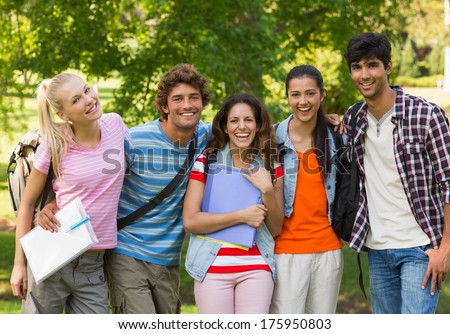 Group portrait of happy college friends standing in the campus - stock photo