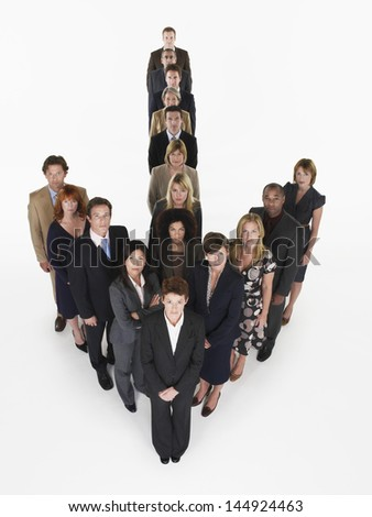 Group portrait of multiethnic businesspeople in arrow formation against white background - stock photo