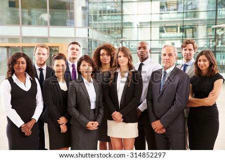 Group portrait of serious corporate business colleagues - stock photo