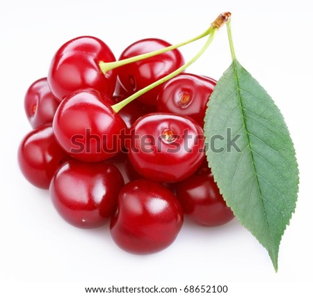 Group ripe cherries with a leaf on a white background. - stock photo