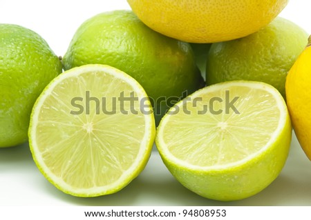 Group several lemons and limes on white background - stock photo