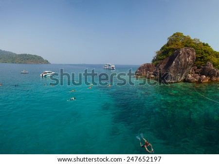 Group snorkeling people in Adaman sea near Thailand iland Koh Chang, panoramic picture - stock photo