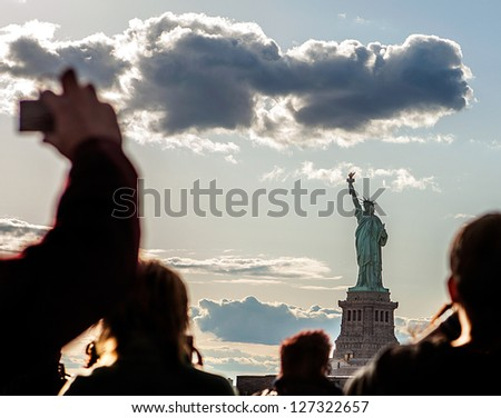 Group Tourists, Statue of Liberty Ferry, NYC. - stock photo