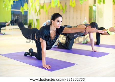 Group women stretching traning exercising in gym practicing yoga pilates - stock photo