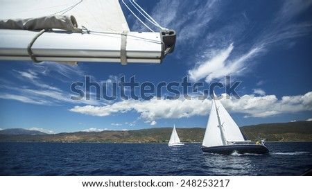 Group yacht sailing. Sailing yacht race. Sailing boat in the sea. Luxury yacht. - stock photo
