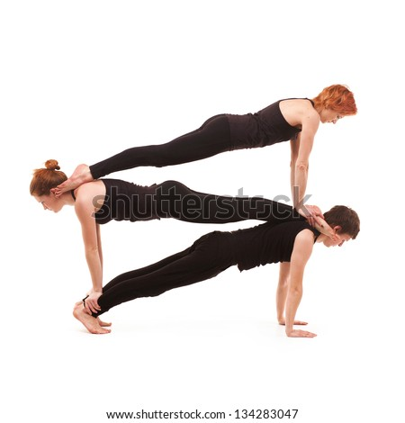 Group yoga. Man and two women practicing yoga on a white background - stock photo