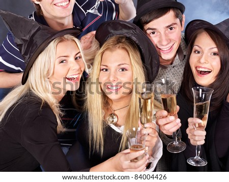 Group young people drink champagne at nightclub. - stock photo