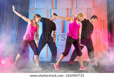 Group young people practicing fitness dance  - stock photo