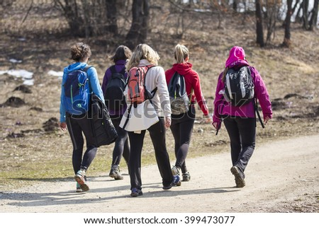 Group young women during hiking in woods - stock photo
