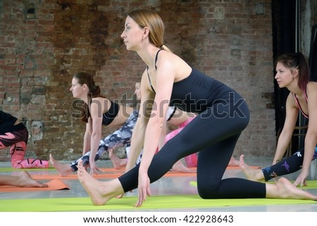 Group young women stretching and practices yoga - stock photo