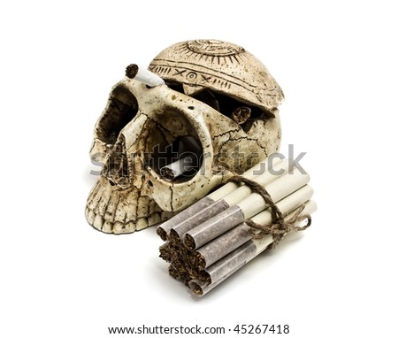 grouped cigarettes  and big skull - stock photo