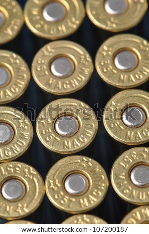 Grouping of .357 magnum bullets arranged in rows - stock photo