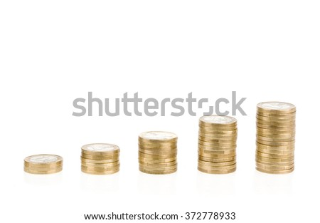 Growing one euro coin stack isolated on white background. Growing savings symbol - stock photo
