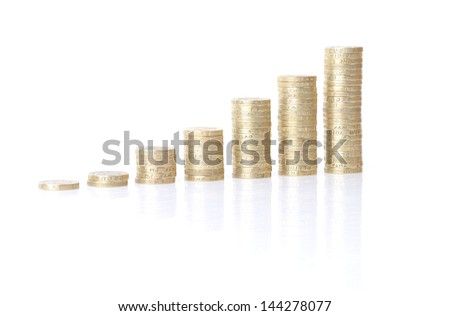 growing stacks of coins isolated on white background - stock photo