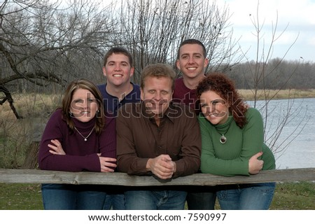 grown children with dad - stock photo