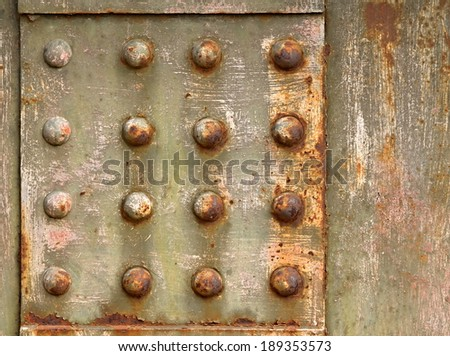 grown old gray background with steel rivets to rust - stock photo