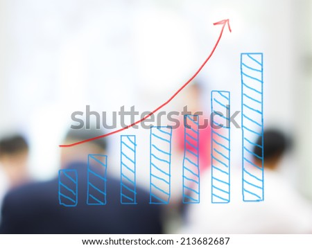 growth bar chart with blurred business people background - stock photo