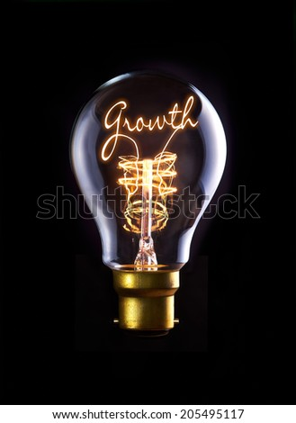 Growth concept in a filament lightbulb. - stock photo