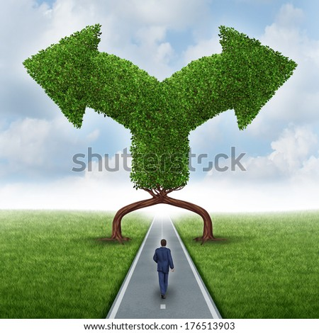Growth direction choice business concept as a businessman walking on a road with two trees shaped as arrows in different directions as a metaphor for a crossroad dilemma for a career or investment. - stock photo