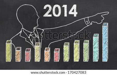Growth in 2014 with Creative Businessman showing Positive Graph - stock photo