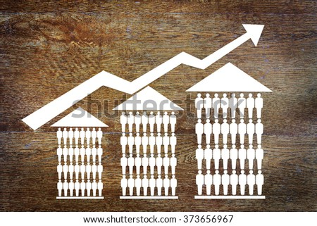 Growth sales of houses. Abstract image with paper scrapbooking - stock photo