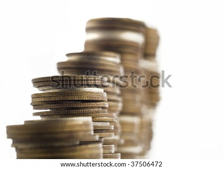 Growth - towers assembled of coins shallow DOF with focus on the left side of the image - stock photo