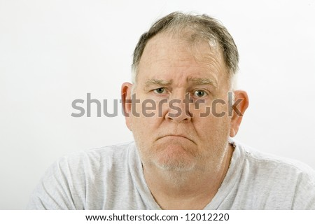 grumpy big guy ragged and unshaven - stock photo
