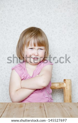 Grumpy - girl making faces  - stock photo