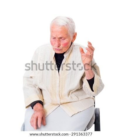 Grumpy old woman telling all her problems with strong gesticulations. - stock photo