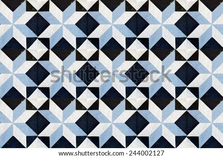 Grunge and vintage ceramic tiles wall decoration - stock photo