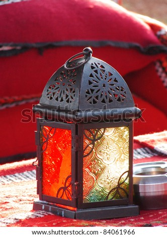 grunge arab lamp with a candle inside - stock photo