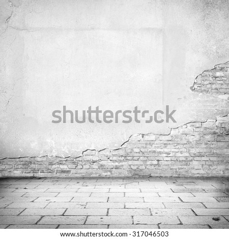 grunge background, damaged brick wall texture bright plaster wall and blocks road pavement abandoned exterior urban background for your own concept or project - stock photo
