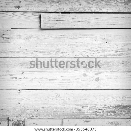 Grunge background of weathered painted wooden plank - stock photo