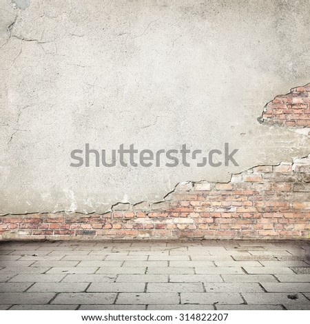 grunge background, red brick wall texture bright plastered wall and blocks road pavement abandoned exterior urban background for your concept or project - stock photo