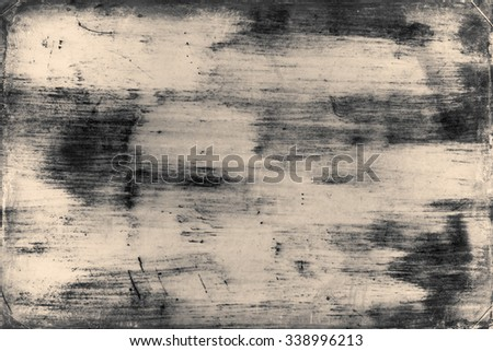 Grunge background texture image. Old abstract vintage black wallpaper. Dirty paper art with scratches and stain. Rough dark aged canvas with dirt and brush lines. Vignette light and shadow effect. - stock photo