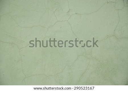Grunge Background. Wall with the colored turquoise whitewash falling off fragment as a background texture - stock photo